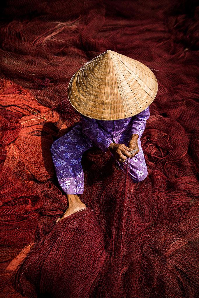 Maroon photo by Réhahn - fishing net in Hoi An Vietnam