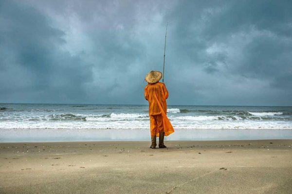 an old man fishing in Vietnam